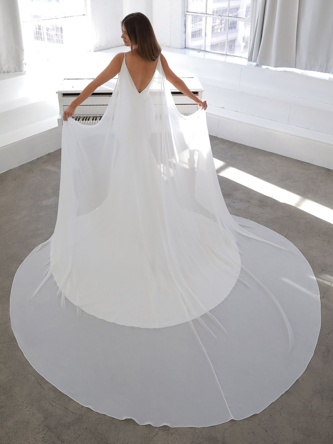 Nelia with cape from Enzoani available at emily bridalwear in Sheffield