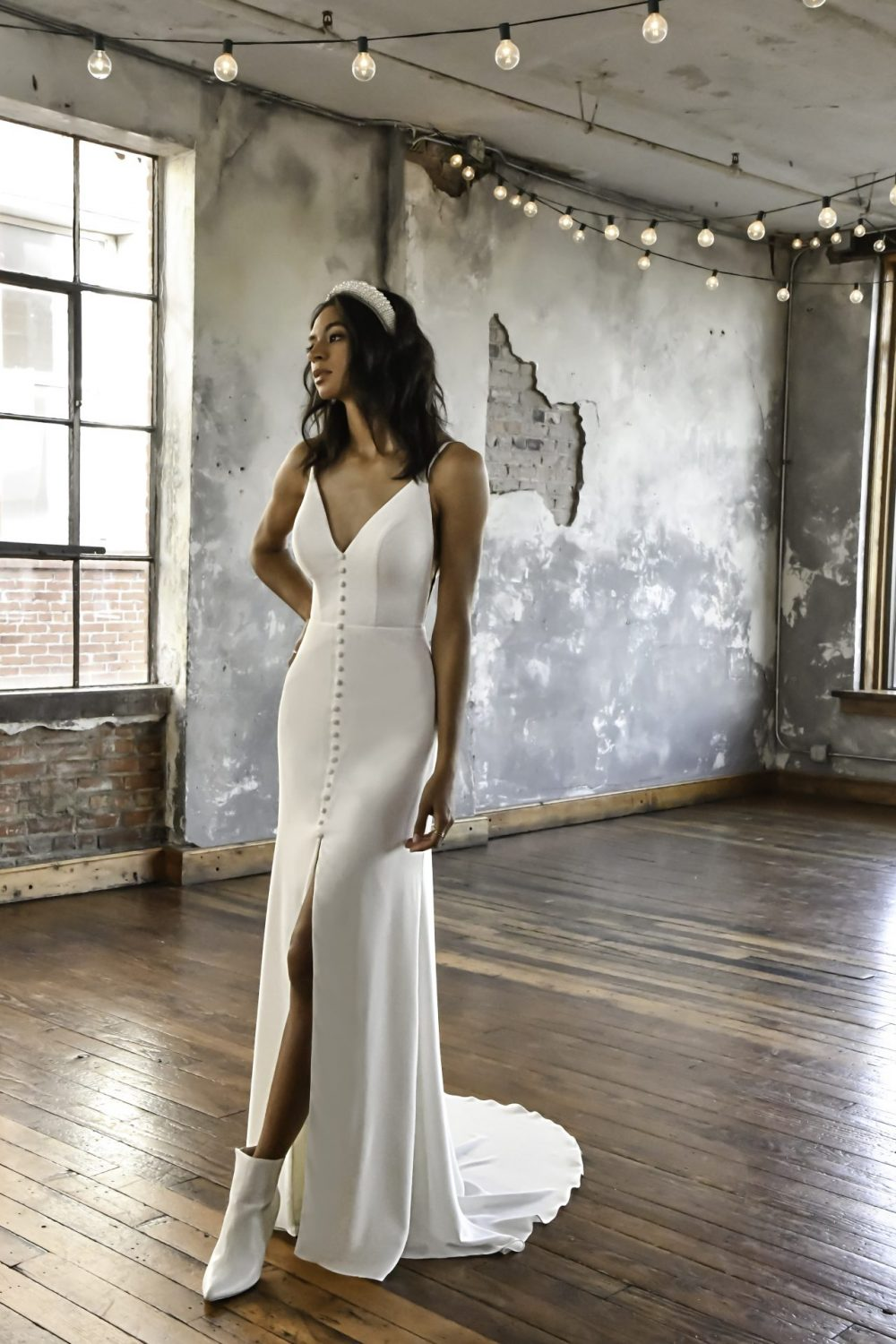 Relaxed soft aline crepe modern wedding dress Tatum, from All Who Wander is available from Emily Bridalwear in Sheffield, South Yorkshire.